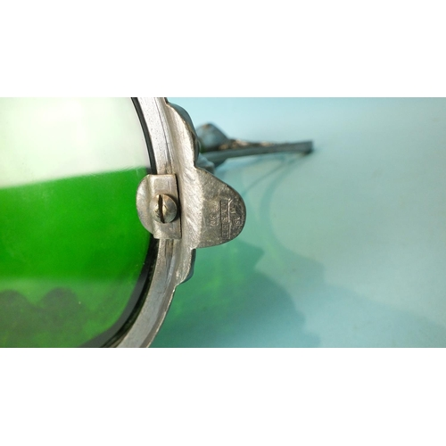 215 - A WMF Claret jug, the trumpet-shaped green glass body within the plated frame and whiplash handle an...