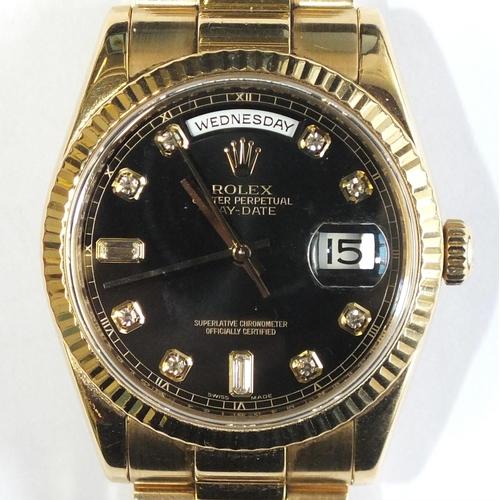 256 - A gentleman's 18ct gold Rolex Oyster Day-Date wrist watch c2008, the fluted bezel enclosing a black ...