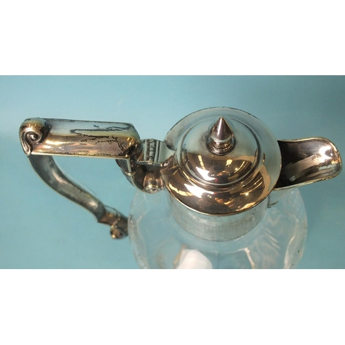 463 - A Victorian cut-glass claret jug with plated mounts, handle and hinged lid, 26cm high....
