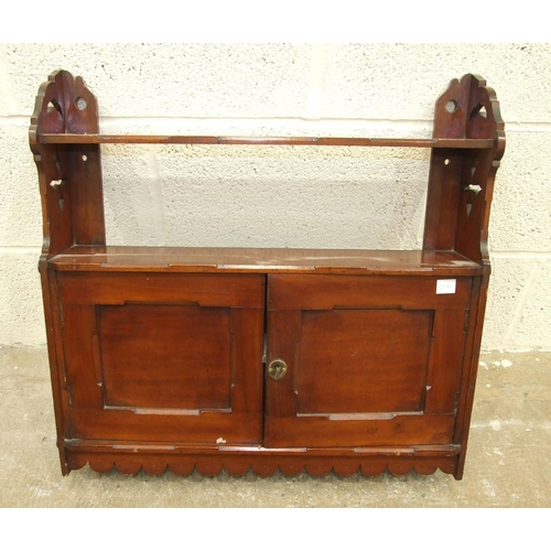 53 - An Edwardian mahogany small two-door wall cupboard fitted with a shelf, 61cm wide, 57cm high....