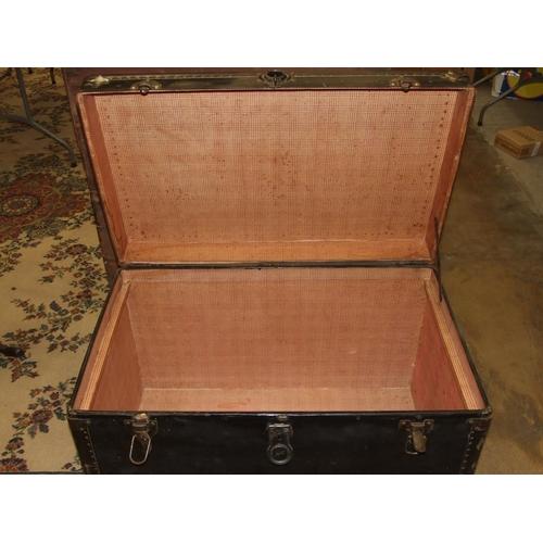 54 - A metal-bound cabin trunk, 90cm wide, 58cm high, 53cm deep.