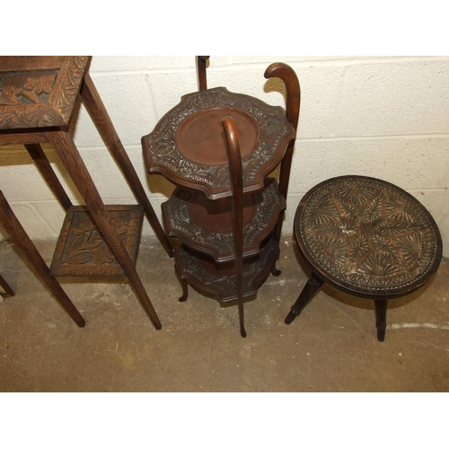 58 - A carved wood three-legged table, a three-tier cake stand and a plant stand, (3).