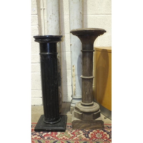 50 - A pair of painted wood pillars, 204cm and 194cm high and two wood pedestals, 90cm and 95cm high....