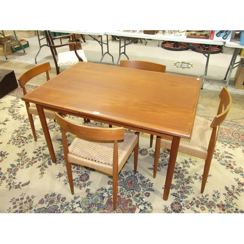 56 - A set of four 1960's Danish Mogens Kold teak dining chairs with woven seats, each labelled, together...