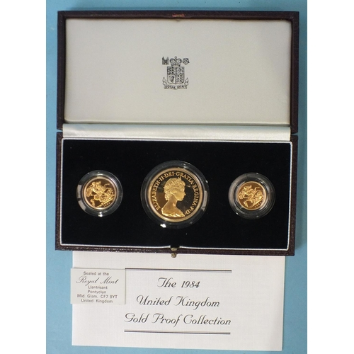 A Royal Mint cased 1984 United Kingdom gold proof collection comprising 22ct five-pounds, sovereign and half-sovereign, in capsules, with certificate of authenticity.