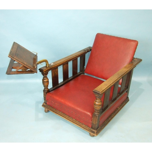 61 - A pair of 1930's oak deep-seated armchairs with adjustable backs, on later castors, one with adjusta...