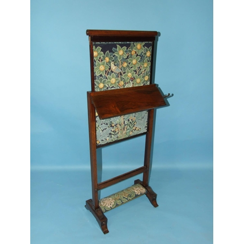 63 - A William IV rosewood screen with rising centre section and small adjustable shelf, on end supports,...