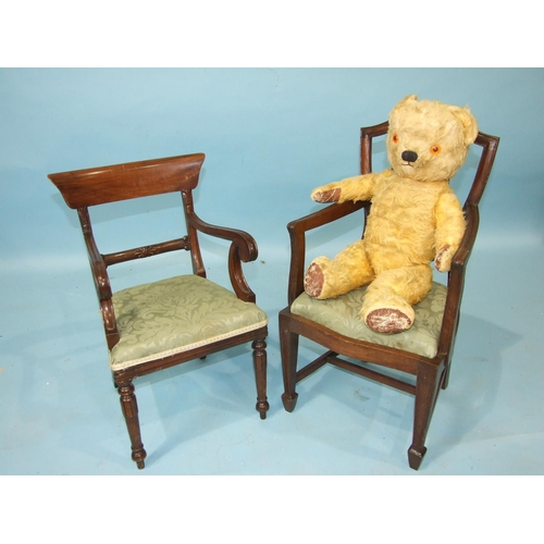 67 - A miniature mahogany carver chair in the early-19th century style, with upholstered seat, on turned ...