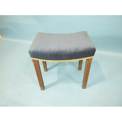 68 - A George VI oak coronation stool by Waring & Gillows, the shaped seat re-upholstered in blue vel...