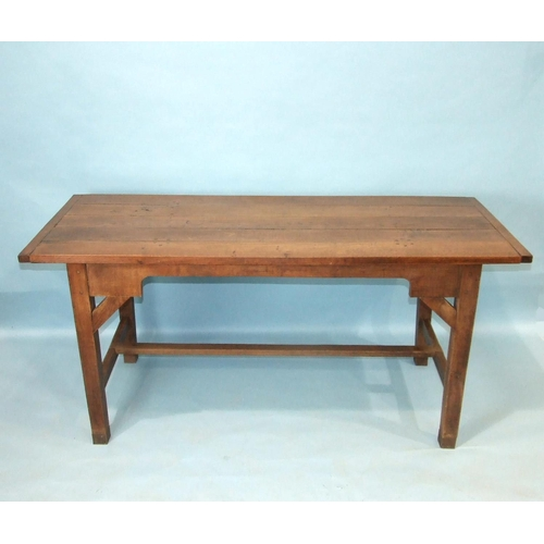 69 - A reconstructed oak farmhouse-style table, the planked top on square tapered legs joined by stretche...