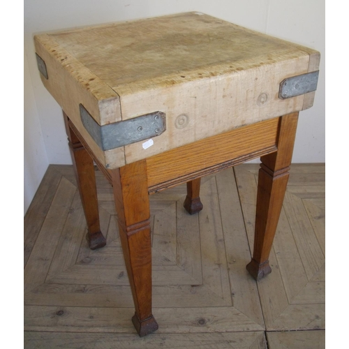 367 - Square top butchers block on oak table base (61cm x 61cm x 87cm)...