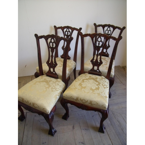 387 - Set of four quality reproduction Chippendale style mahogany dining chairs with upholstered seats on ...