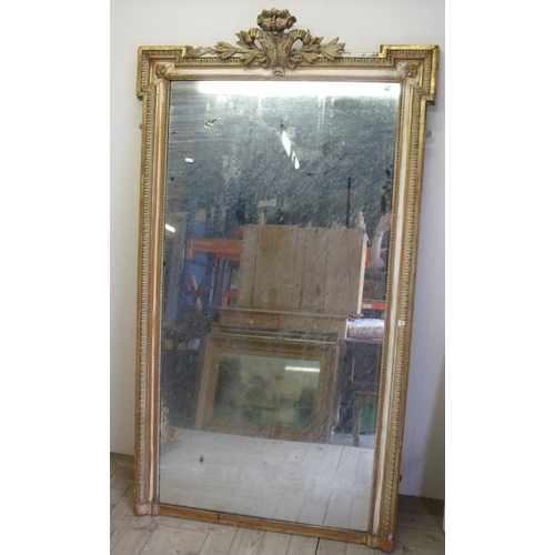 202 - Large 19th C gilt framed console mirror with plasterwork crested top (104cm x 180cm)...
