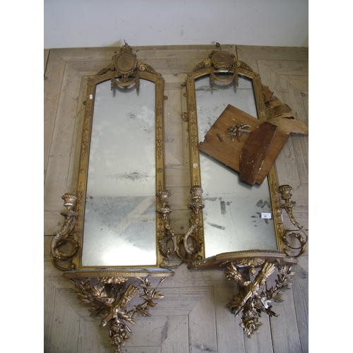 69 - Pair of 19th C gilt wall mirrors with silk cushion upholstered shelves with twin candelabra supports...