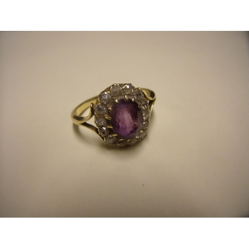 188 - Unmarked 18ct gold diamond & amethyst flower head ring...