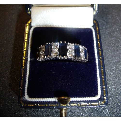180 - 18ct gold diamond and sapphire half eternity ring set with five baguette shaped sapphires and eight ...