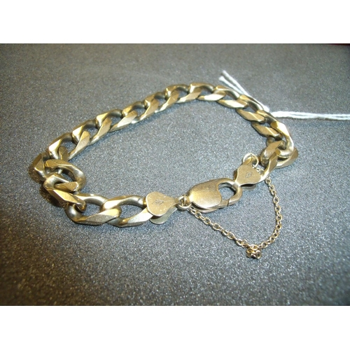 182 - 9ct gold heavy curb link bracelet with safety chain, overall length 18cm (24grams)...