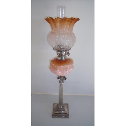 31 - Victorian silver plated Corinthian column oil lamp with stepped square base and coloured glass reser...