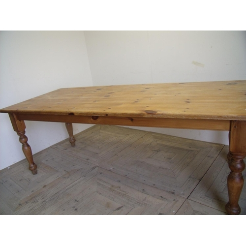 332 - Rectangular pine kitchen table on turned supports (91cm x 213cm)...