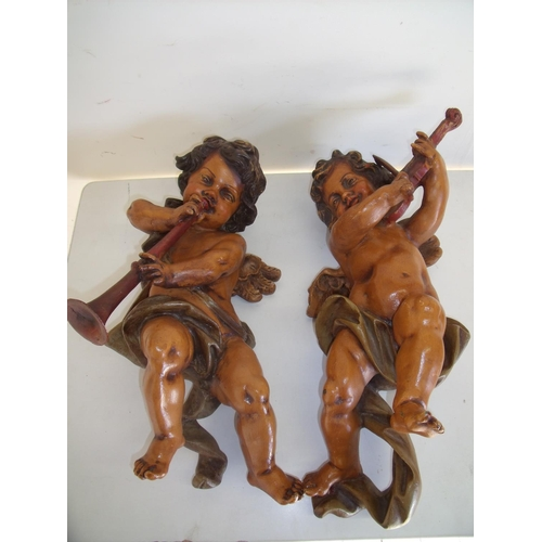 39 - Pair of painted carved musical cherubs (approx. 52cm high)...
