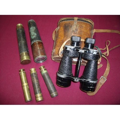 16 - Brown leather cased pair of British military issue binoculars Bino Prism No5 mk 3x7 No36009, three s...