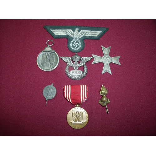 2 - Group of mostly German related military badges, medals etc including cross, Winterschlacht Im Osten ...