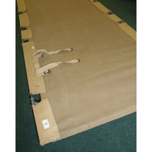 27 - Military style canvas and metal framed camp bed...