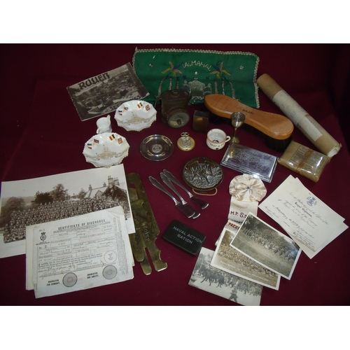 39 - Box containing a large selection of various military related items including brass button slides, fi...