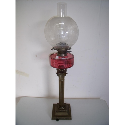 58 - 19th/20th C brass Corinthian column oil lamp with cranberry glass reservoir etched glass shade on sq...