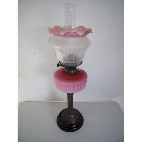 59 - Victorian oil lamp with etched clear & opaque shade and pink glass reservoir on brass column and tur...
