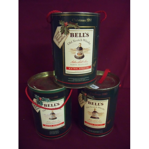 49 - Three cased Bells Christmas commemorative whisky decanter sets 1989, 1990 & 1991...