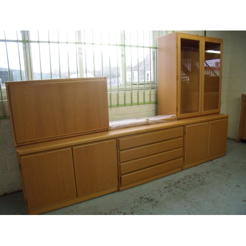 368 - Omann Lightwood lounge suite comprising of low base with four central drawers flanked by four cupboa...