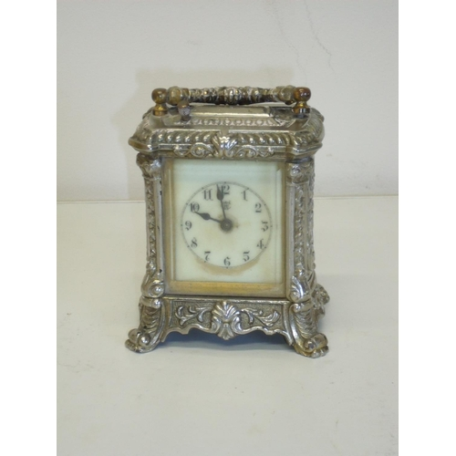 10 - Silver plated Waterbury Clock Co carriage type clock (12cm high)...