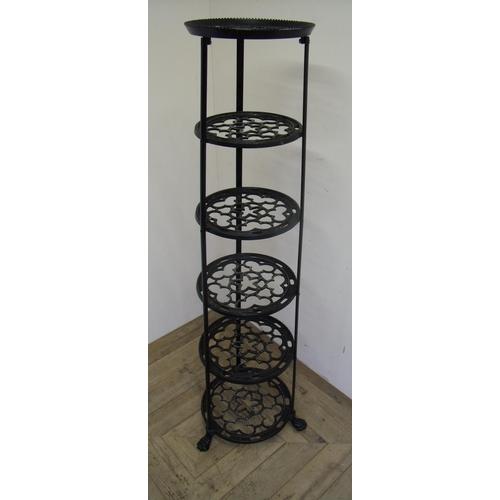 26 - Cast metal six tier graduating pan stand on lion paw feet (122cm high)...