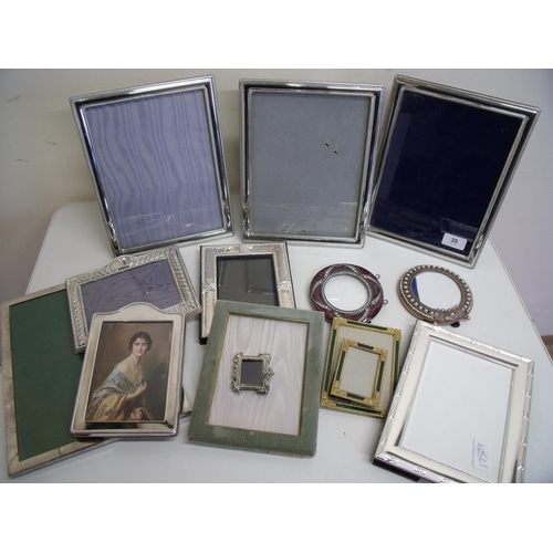 35 - Large selection of various silver plated photograph frames...