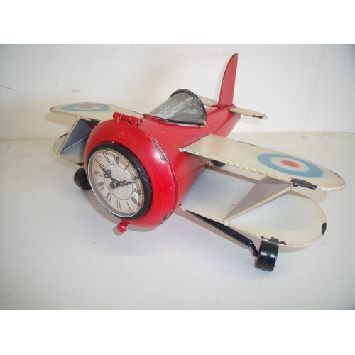 48 - Modern painted tin plate clock in the form of a bi-plane...