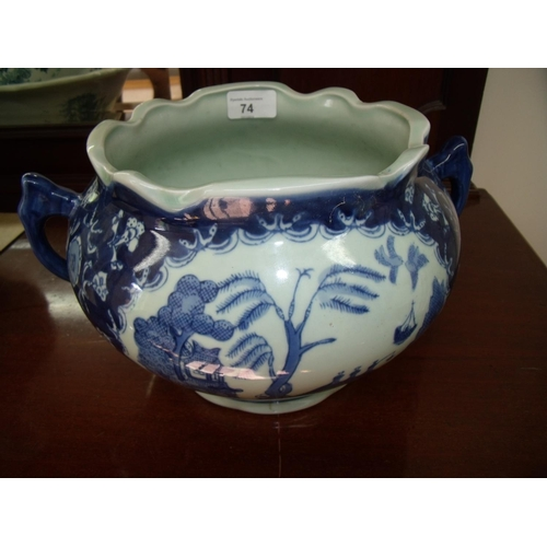 31 - Chinese blue & white twin handled jardinière (18cm high) with four digit signature panel to the base...