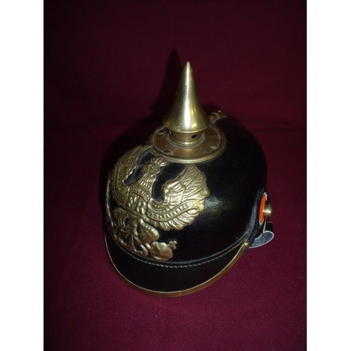 20 - Fine quality copy of a German Pickelhauben helmet complete with liner and brass mounts...