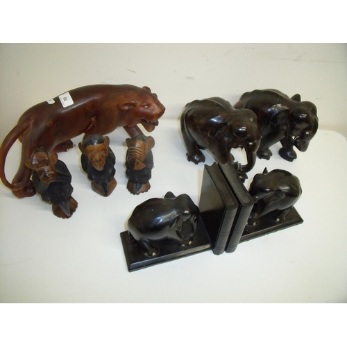 30 - Carved hardwood model of a panther, a pair of carved ebony bookends, a pair of carved wooden elephan...