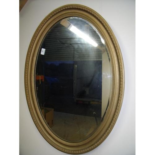 37 - Early 20th C oval gilt framed bevelled edge wall mirror (86.5cm x 61.5cm)...