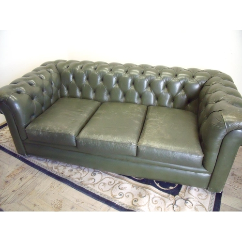 327 - Green leather three seat Chesterfield sofa (width 180cm)...