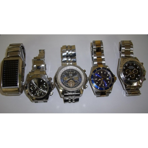 92 - Selection of various designer style wrist watches including copies of Breitling, Rolex etc...