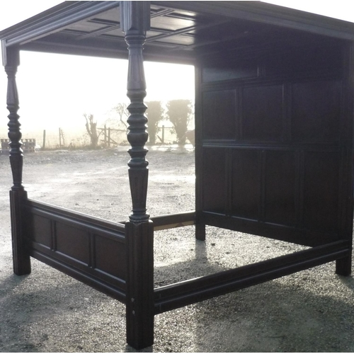 247 - Quality reproduction oak panelled four poster bedstead...