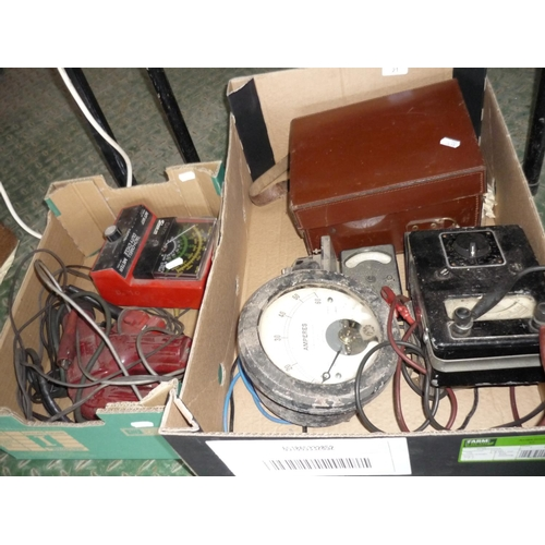 21 - Two boxes of various electrical test meters etc...