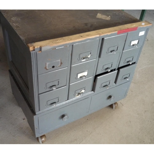 27 - Set of metal filing drawers with various items inside, on wheels...