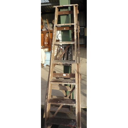 42 - Two sets of wooden step ladders...