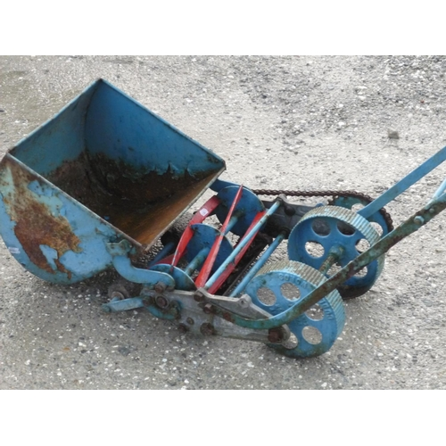 44 - Small push along chain driven lawnmower...
