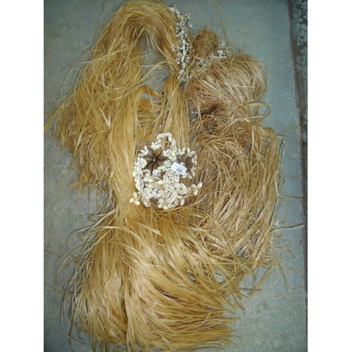 266 - Two Polynesian style grass skirts with shell waistbands...