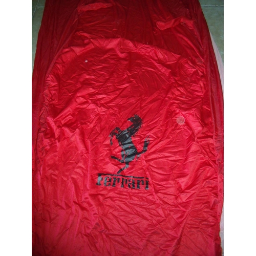 267 - Ferrari car cover and four seat covers, with carry bags...