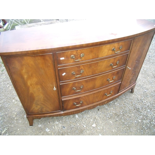 300 - Mahogany dining suite comprising of a bow fronted side cabinet with 4 central drawers flanked by two...